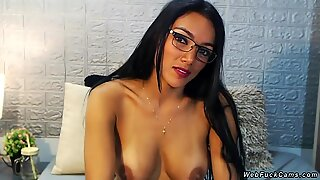 Busty tanned brunette camgirl fucks toy