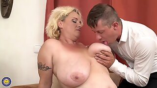 Mature mother with big tits pleasing her boy