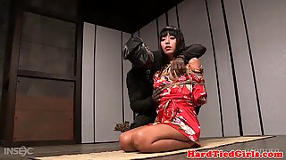 Bound asian beauty submits to toying