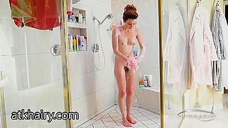 Emma Evins using a shower head to masturbate